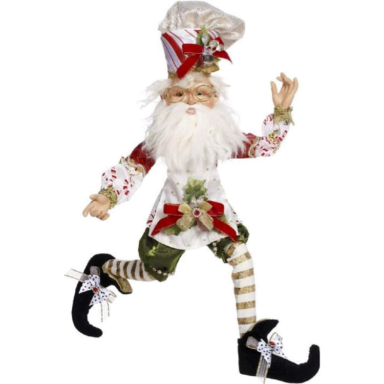 elf in a white chef hat, red and white apron, striped stockings and black shoes.