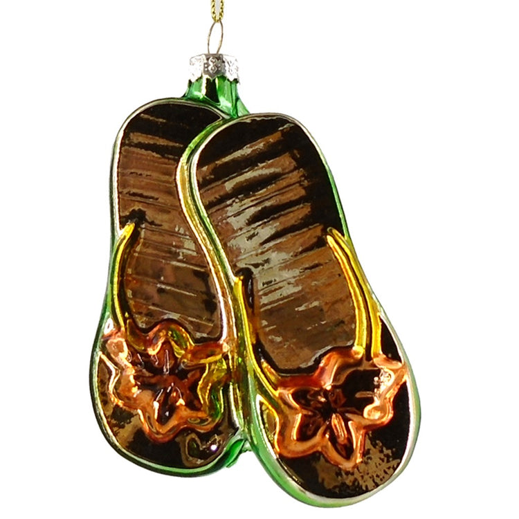 Orange flip flop shaped Christmas ornament with floral design on front.