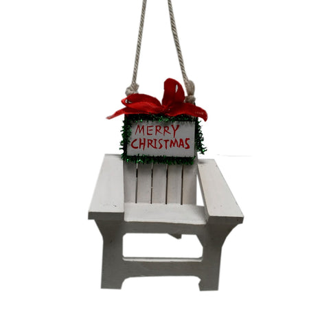 "Christmas ornament shaped like an adirondak chair. White with red ribbon and text ""Merry Christmas""."