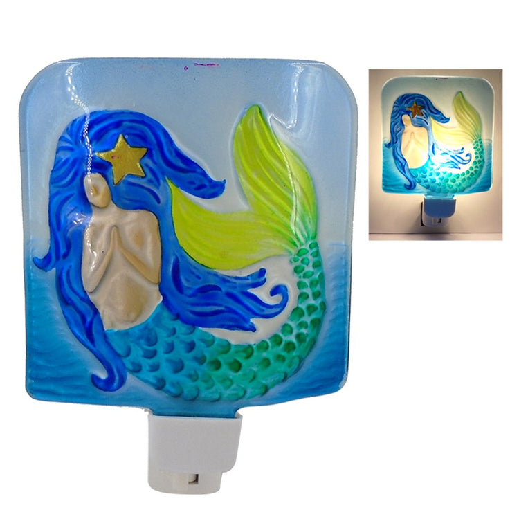 Square shaped night light in blues with mermaid picture.