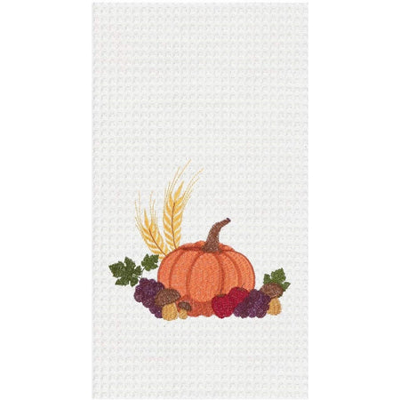 White waffle weave dish towel with orange pumpkin, grapes, apples and mushrooms.