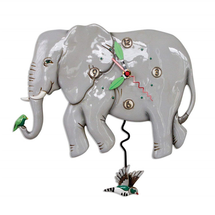 Elephant shaped wall clock with bird pendulum.