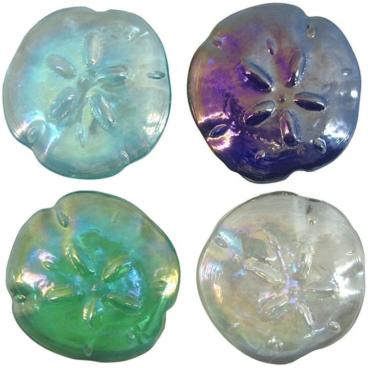 4 iridescent sand dollar shaped paperweights. 1 is dark blue, 1 is green, 1 light blue, 1 is white clear.