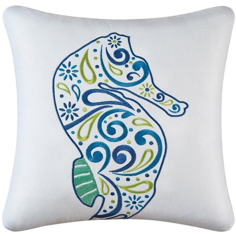 White pillow with blue, teal & green paisley seahorse.