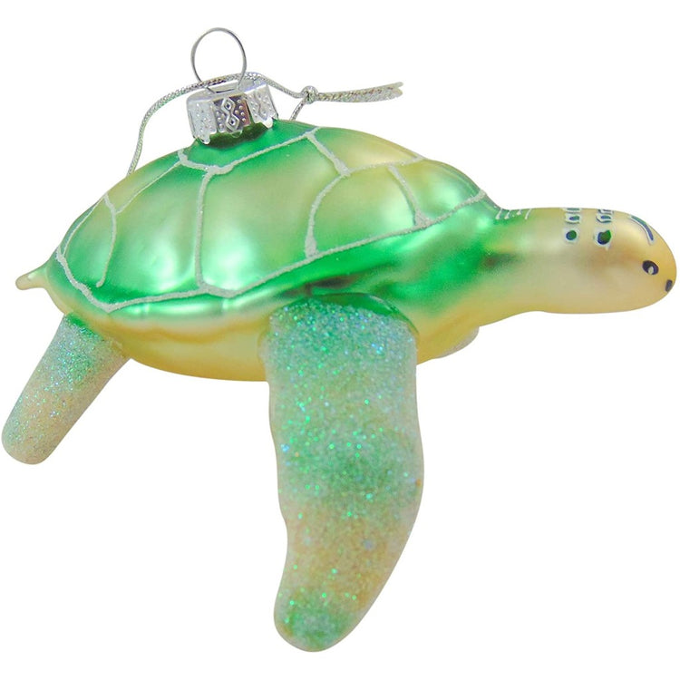 green blown glass turtle ornament with glitter accents and a hand painted face.
