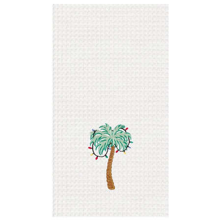 White waffle weave towel with a green palm tree with colorful Christmas lights in it.