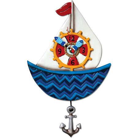 Blue sailboat with white sails, red flag, captain's wheel, & silver anchor pendulum.
