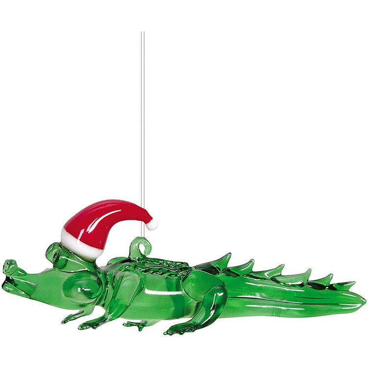 green alligator with a santa hat on