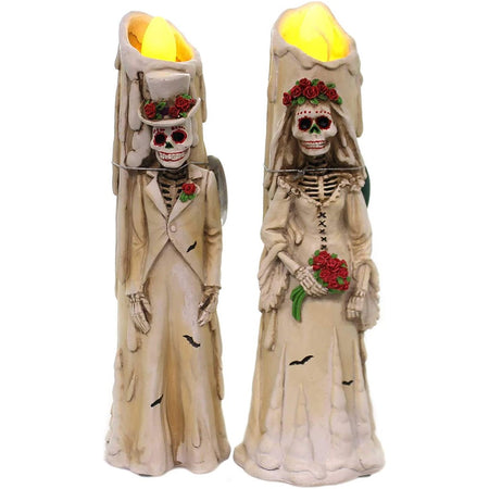 2 candle figurines with led flicker lights. 1 is a Day of the Dead groom, the other is a matching bride.