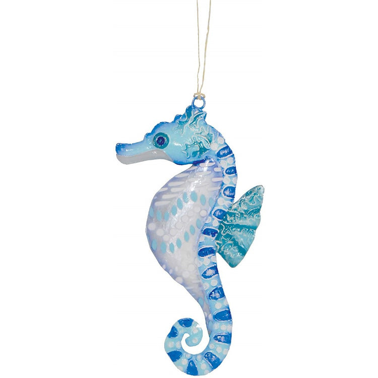 Seahorse shaped Christmas ornament. Shades of blue, green and white.