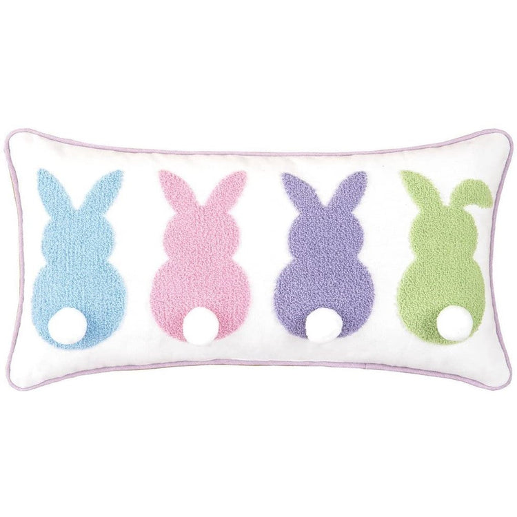 White rectangular pillow with pastel embroidered back view of 4 bunnies with tails.