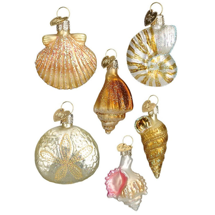 6 blown glass shells and starfish ornaments. The shells are white and tan with pink and glittery accents.
