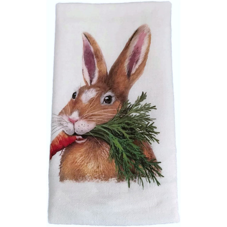 White kitchen towel with a brown rabbit holding a carrot in its mouth.