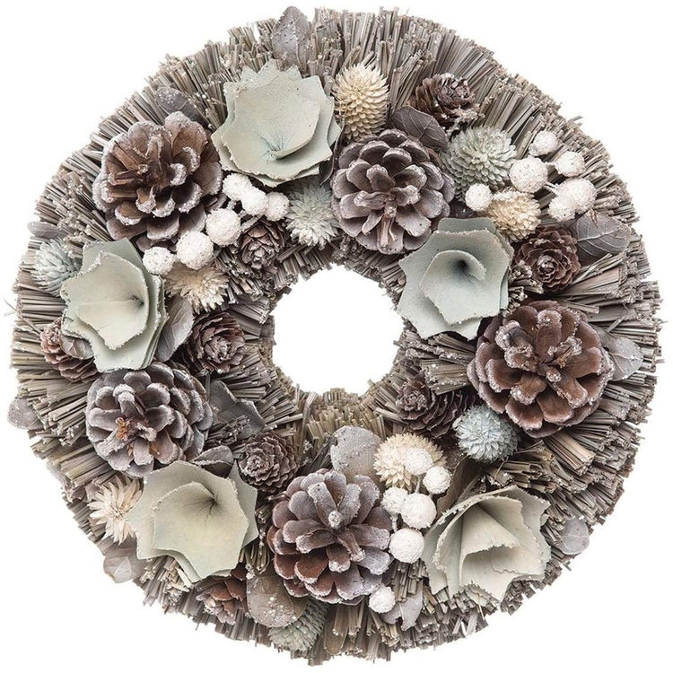grey hay wreath with natural woodland items in it like pinecones