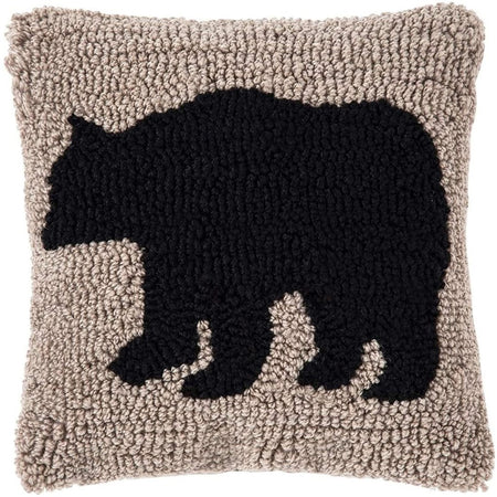 Square pillow featuring a black bear on tan background made with small knots