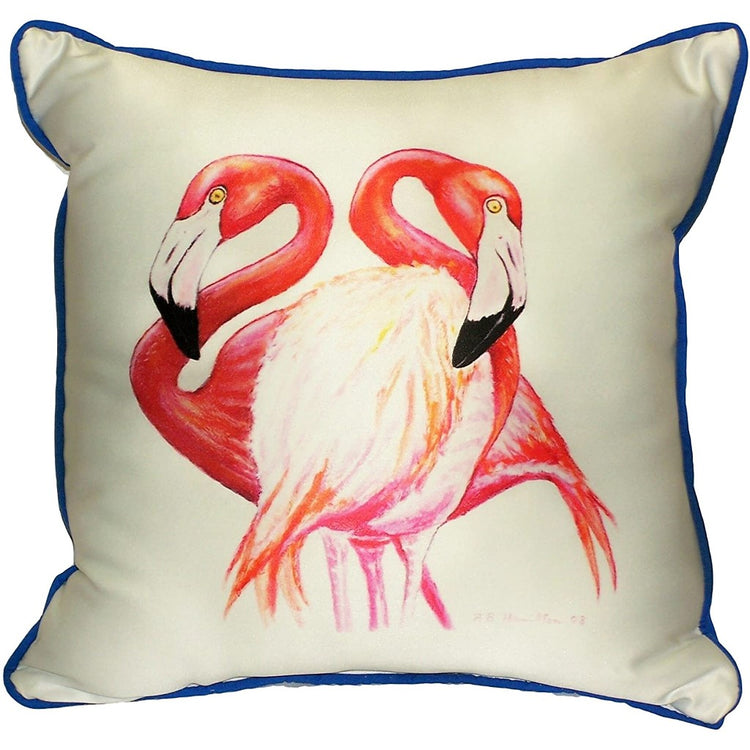 White pillow with blue border and 2 pink flamingos