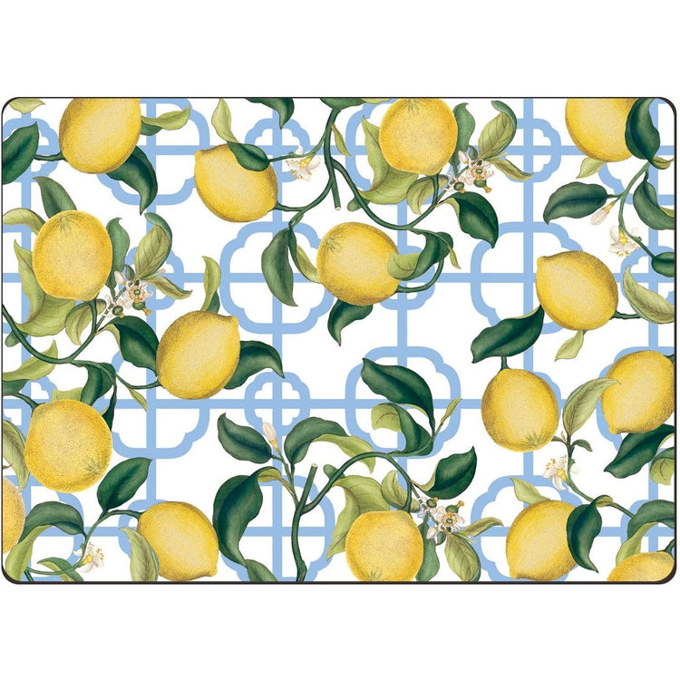 Rectangular white placemat with a lemon design over a blue fretwork pattern.