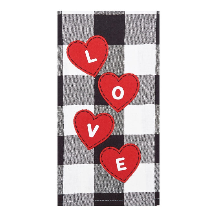 Black, white, and grey checkered kitchen towel with 4 red hearts that spell L O V E.