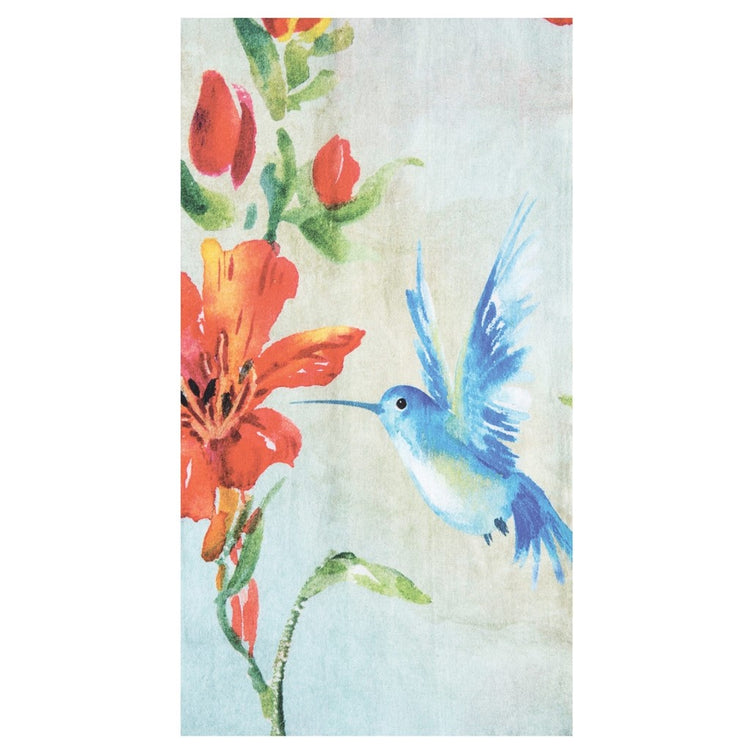 Folded dishtowel with blue humming bird next to red flowers.