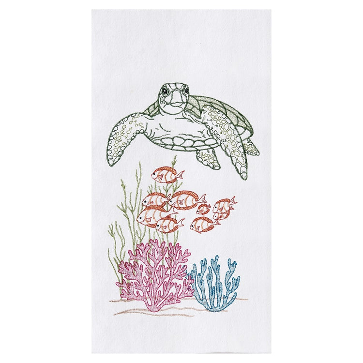 White towel, green turtle swims above school of gold fish, green, teal and pink coral below.