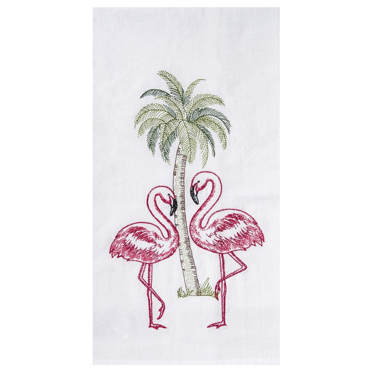 White flour sack kitchen towel embroidered with  2 pink flamingos in front of palm tree.
