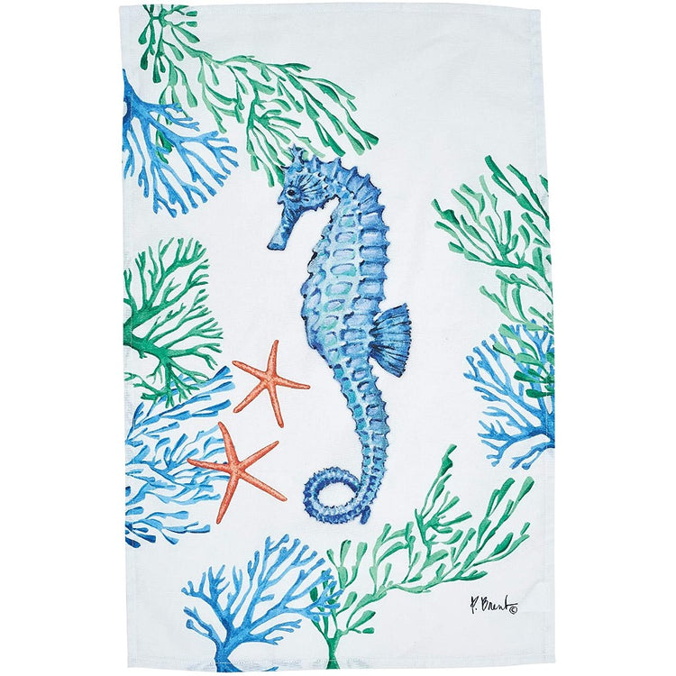 White towel with a blue seahorse, blue & green coral, & 2 orange starfish.