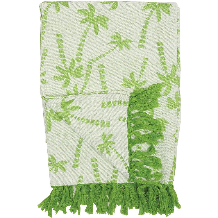 Lime green palm trees on the blanket, with lime green tassels.