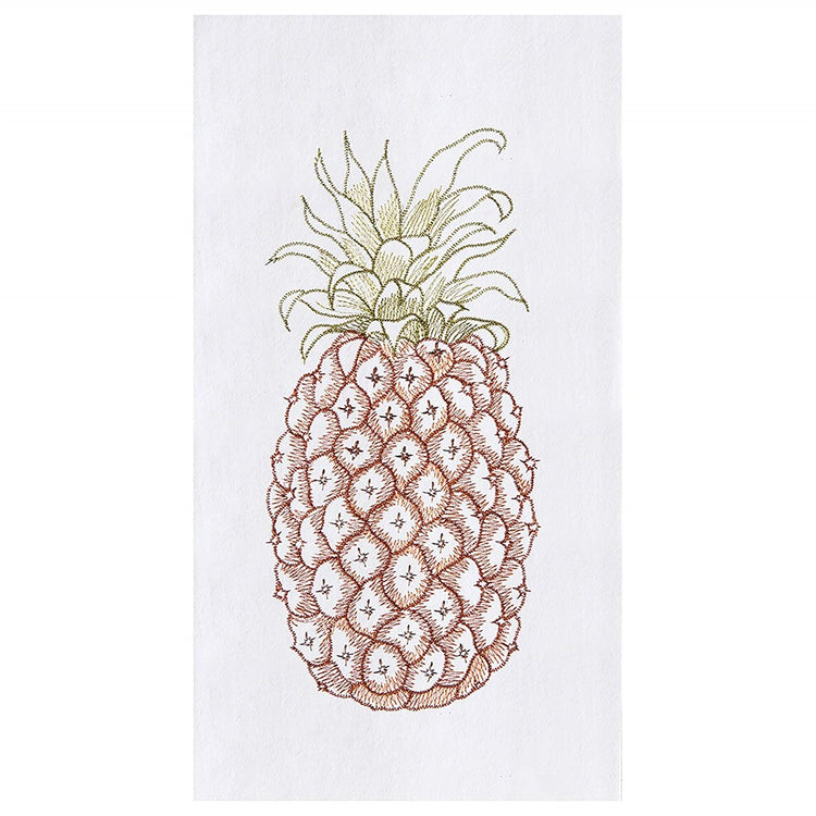 White kitchen towel. Brown textured pineapple with green leaves on the top.