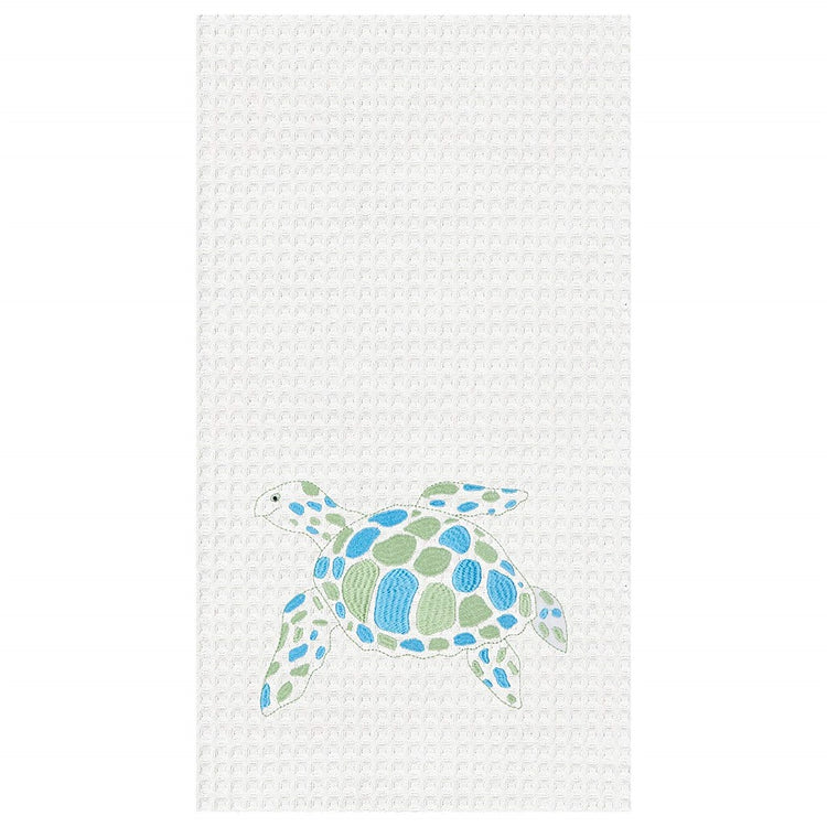 White towel with swimming sea turtle spotted in blue & green,