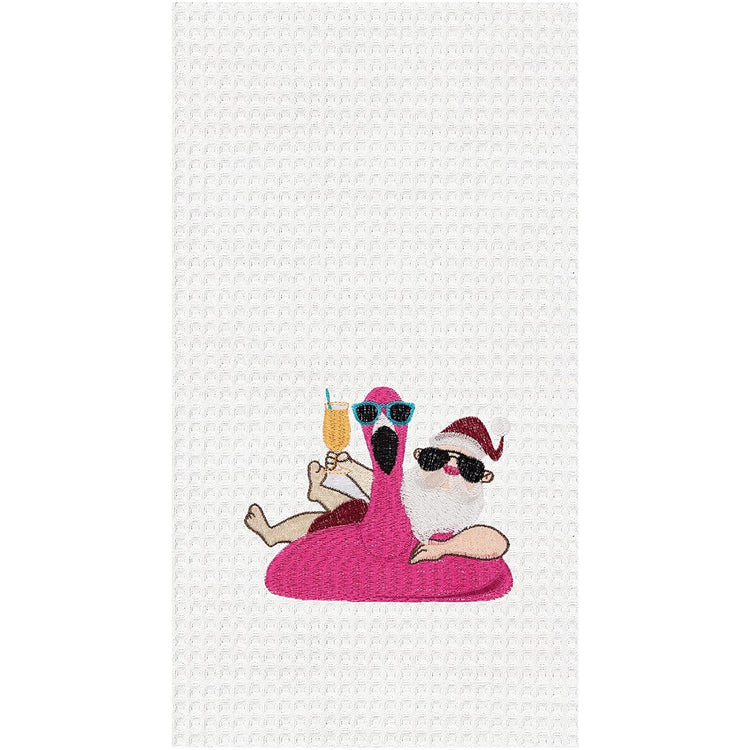 White waffle weave towel with embroidered Santa in a flamingo pool float.