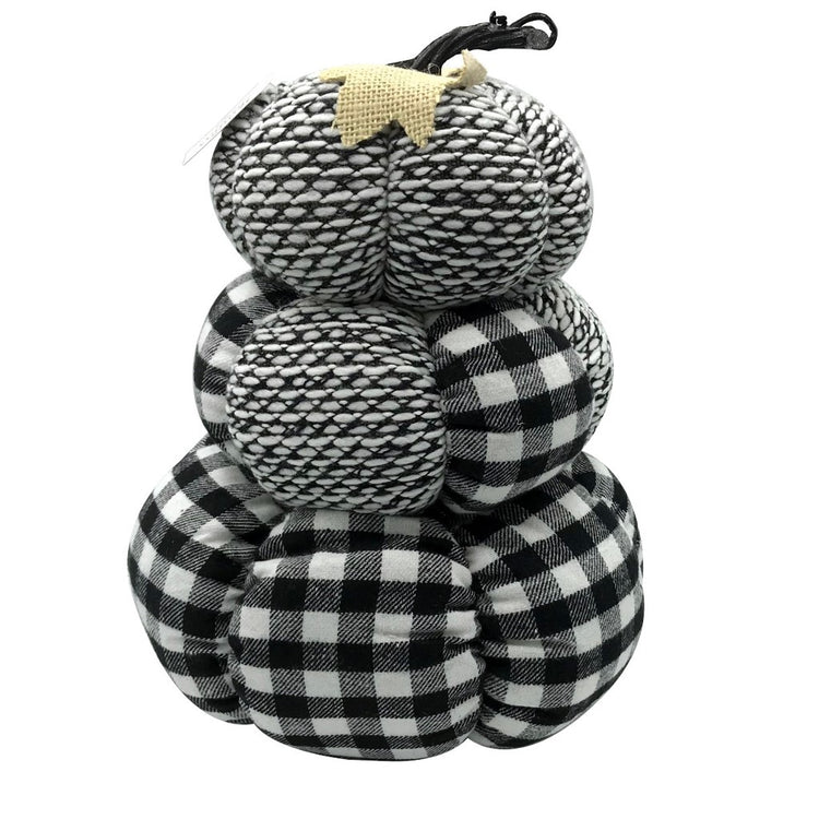 Stack of 3 pumpkins make of a white, grey and black pattern cloth material. A short cloth vine & leaf is on top of the stack