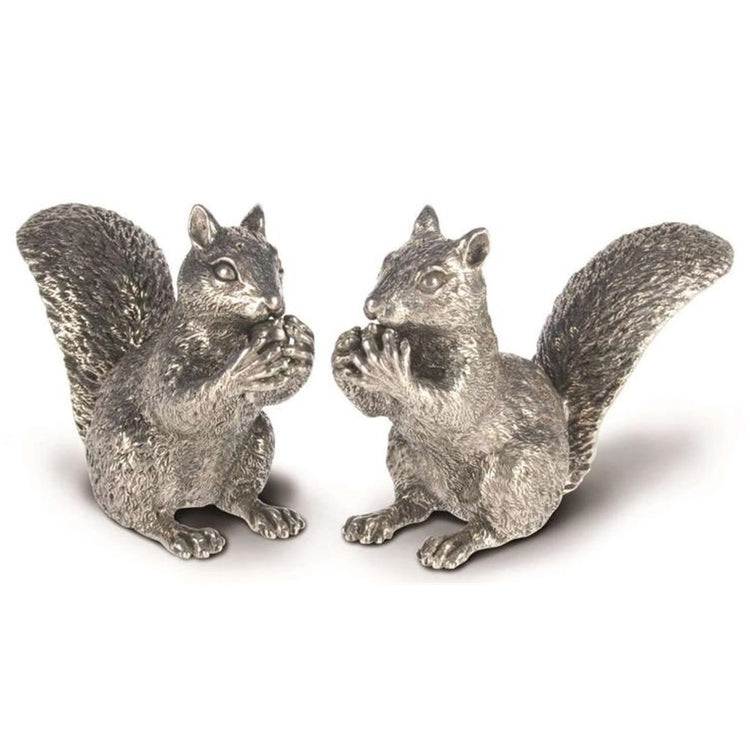 Silver squirrels holding a silver nut to their mouths.