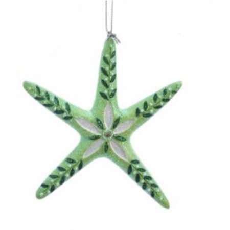 Thin green starfish ornament with dark green leaves in each leg. White & dark green flower in middle.