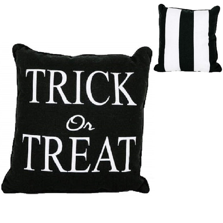 Black pillow with white stripes on 1 side & saying 'Trick or treat' on the other.