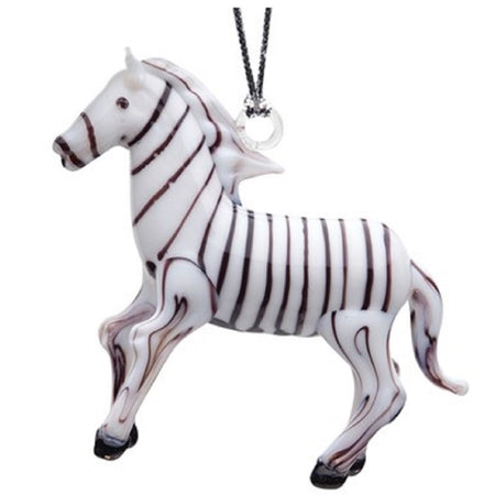 Glass standing zebra, white with brown stripes on entire ornament. Hooves and eye are brown. Hanger attached to mane.