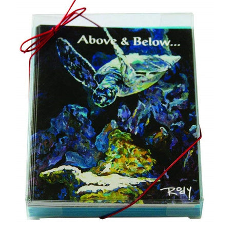 "Boxed Christmas cards with a swimming sea turtle.  Dark shades of blue and green with text ""Above and below...""."