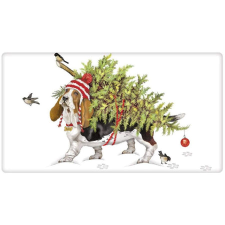 Folded dishtowel with a basset hound print.  Dog is carrying a Christmas tree on his back with 2 birds in photo.