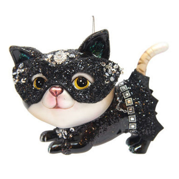 Cat shaped figurine hanging ornament.  Dressed as a bat with skit and mask.