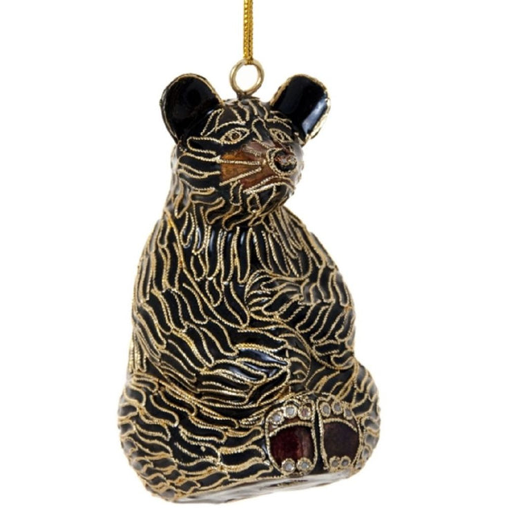 Black bear shaped hanging Christmas ornament with gold metal accent.