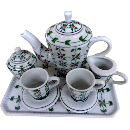 Tea set for 2 on tray.  Red and green berry fine accent on tray, teapot, creamer, sugar, 2 cups and saucers.