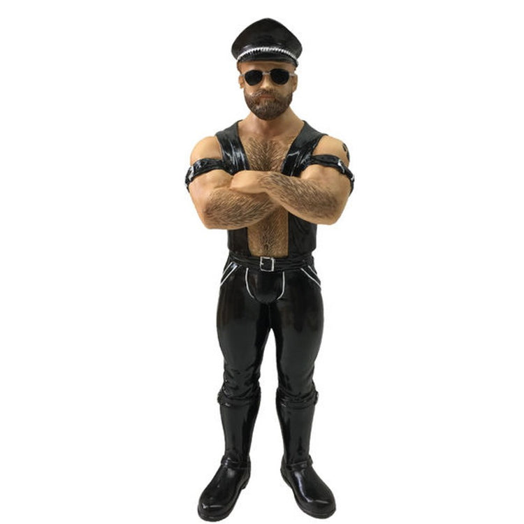 Man dressed in typical biker gear like black leather and hat.  Figurine hanging ornament.
