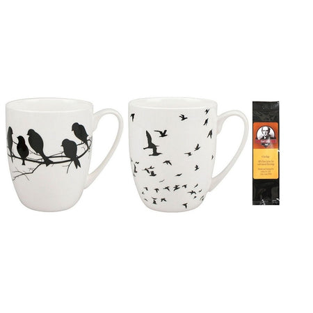 2 mugs with a black package of 6 teabags. Both mugs are white with black bird designs.
