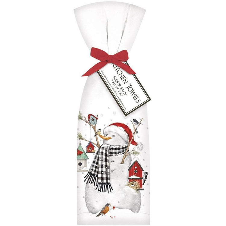 White flour sack kitchen towels tied with red ribbon imprinted with snowman holding birdhouses.