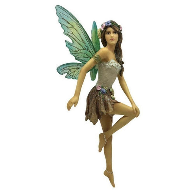 Fairy figurine shaped hanging ornament.  She is standing with one knew bent, shades of tan dress and floral headband.