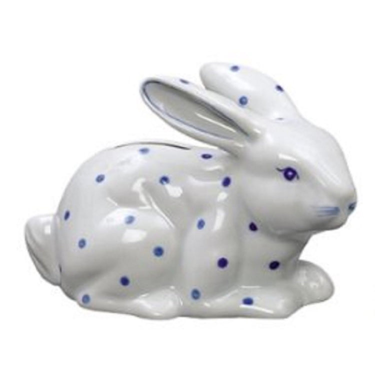 White bunny rabbit shaped bank with blue polka dots.