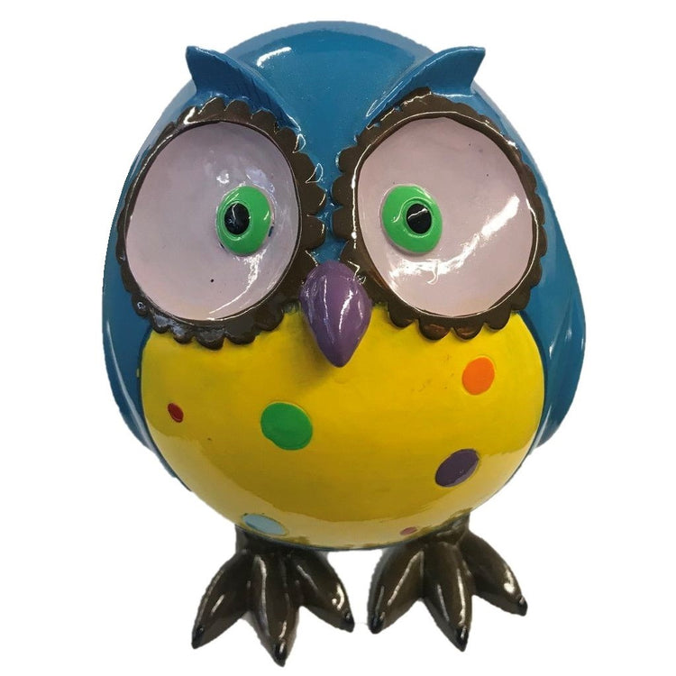 Bright blue owl with green eyes, purple beak, a yellow belly, & rainbow polka dots.