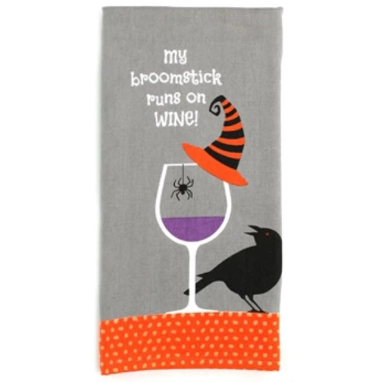 Grey towel with orange bottom trim.  wine glass with witch hat, black bird and spider design.  text:  My broomstick runs on WINE!