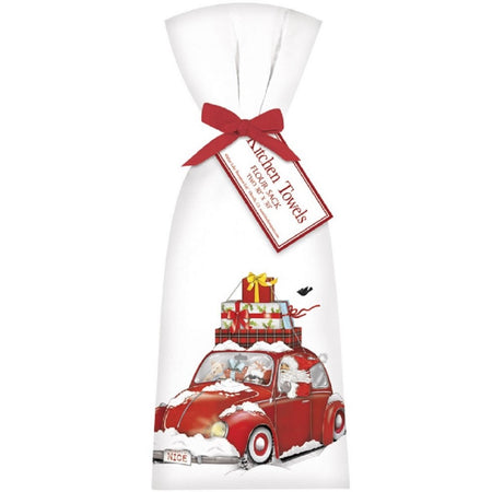 White flour sack kitchen towels tied with red bow imprinted with red bug car stacked with gifts.