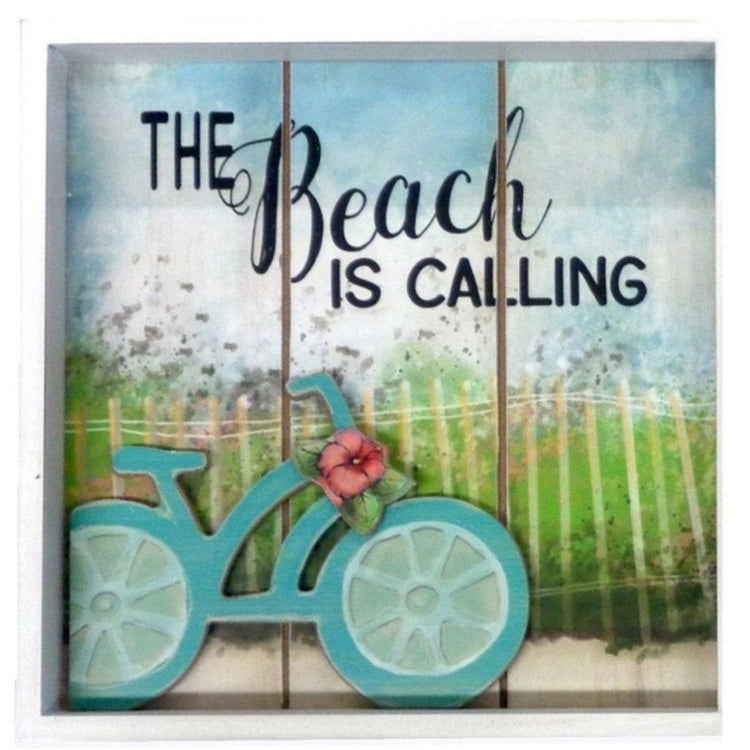 3 wood plank in a white frame. Teal bike with a hibiscus and a picket fence and grass in the background.