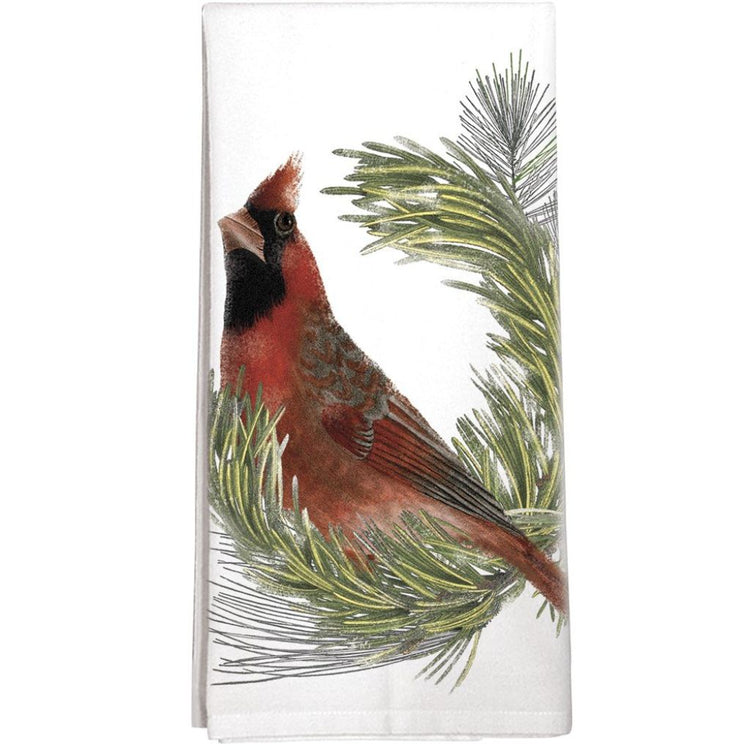 White dishtowel with red cardinal sitting on a pine branch.